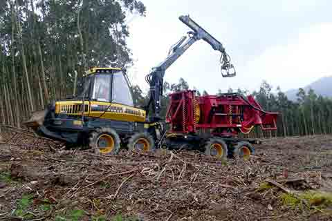 Woodpac Monra Enfo 2000 bundling forestry waste for biomass on forwarder in hard to reach areas of the forest